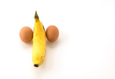 Eggs and banana composing a penis Royalty Free Stock Images
