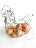 Eggs in The Basket 1. Eggs in the basket on white.Basket like a chicken royalty free stock images