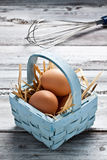 Eggs on a basket. Some fresh raw eggs on a basket stock images