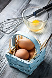 Eggs on a basket. Some fresh raw eggs on a basket stock photo