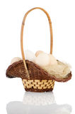 Eggs on a basket Royalty Free Stock Image