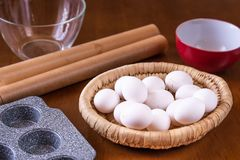 Eggs in basket and baking dish royalty free stock photo