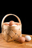 Eggs in basket. Brown and white eggs in a birch bark basket Stock Photos
