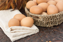 Eggs on the basket and on calico stock photography