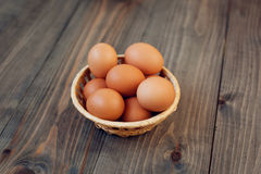Eggs in the basket. Easter eggs in a basket on a dark background stock photos