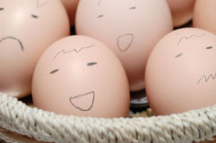 Eggs in Basket with Faces. It is egg, with difference face Royalty Free Stock Images