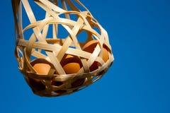 Eggs in basket Stock Image