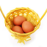 Eggs in basket isolated on white Stock Photo