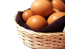 Eggs in a basket isolated on white Royalty Free Stock Photography