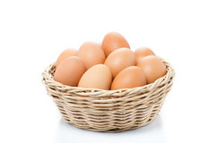 Eggs in basket isolated on white background Stock Photos