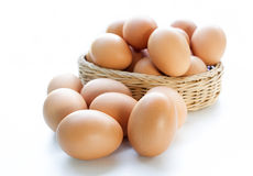 Eggs in basket isolated on white background Stock Image