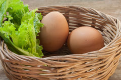 Eggs in a basket with lettuce Stock Photo
