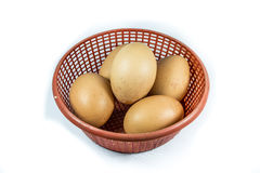 Eggs on basket. Many eggs in basket on white royalty free stock photography