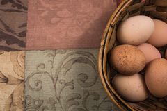 Eggs in basket with neutral background Royalty Free Stock Image