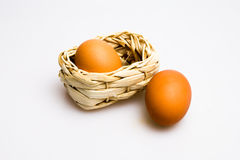 Eggs and basket. On plain background Stock Photography