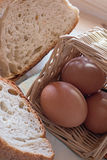 Eggs in the basket, and slices of bread Stock Photo