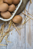 Eggs in a basket. Some fresh chicken brown eggs ready to  cooking royalty free stock images