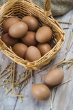 Eggs in a basket. Some fresh chicken brown eggs ready to  cooking stock image