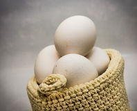 Eggs in basket. Some eggs inside a basket stock photos