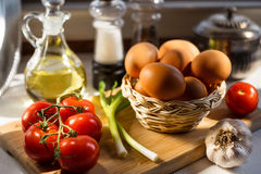 Eggs in a Basket with Vegetables Stock Photography