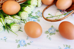 Eggs in the basket. On wallpaper background Stock Photo