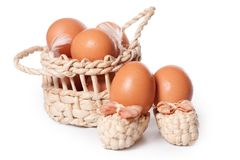 Eggs in the basket on a white Stock Image