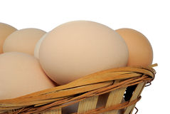 Eggs in a basket on white Stock Images