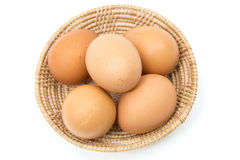 Eggs in the basket on white Stock Photography