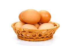 Eggs in a basket. On a white background Stock Photo