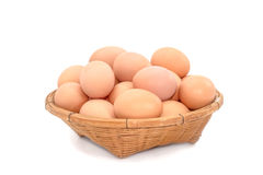 Eggs  in the basket on white background Royalty Free Stock Photo