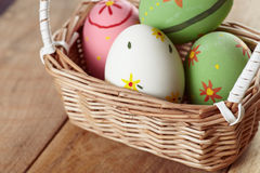 Eggs in basket on wood a Royalty Free Stock Images