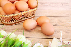 Eggs in the basket. On wooden background Royalty Free Stock Images