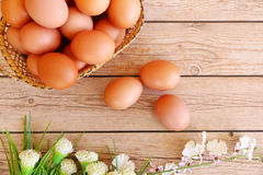 Eggs in the basket. On wooden background Stock Photo