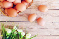 Eggs in the basket. On wooden background Stock Image
