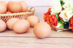 Eggs in the basket. On wooden background Stock Photography