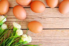 Eggs in the basket. On wooden background Royalty Free Stock Photos