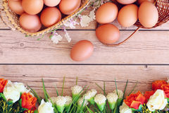 Eggs in the basket. On wooden background Royalty Free Stock Image