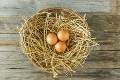 Eggs in the basket. With wooden background Stock Photo