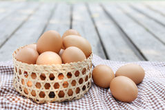 Eggs in the basket Stock Photo