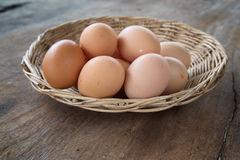 Eggs in the Basket. On wooden table Royalty Free Stock Photo