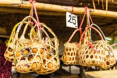 Eggs in  baskets. Eggs in a basket for boiling in hot springs Royalty Free Stock Photography