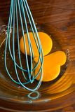 Eggs with beater tool Stock Photo
