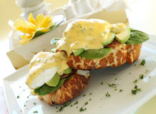 Eggs Benedict. Beautiful eggs benedict with bacon and a rich hollandaise sauce on tiger crust bread stock image