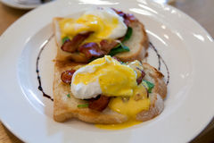 Eggs Benedict with Bacon and Spinach Stock Photo