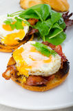 Eggs benedict with bacon and spinach Royalty Free Stock Photography