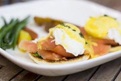 Eggs Benedict with Bearnaise Sauce & Smoked Salmon. Toasted English Muffin with Two Poached Eggs, Spinach, Smoked Salmon, and Béarnaise Sauce Royalty Free Stock Photo