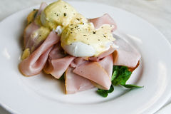 Eggs benedict breakfast with smoked ham. And spinach, and hollandaise sauce Royalty Free Stock Photos