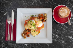Eggs benedict with cafe latte coffee Stock Photography