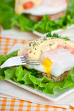 Eggs Benedict with fish for breakfast Royalty Free Stock Images