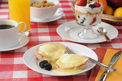 Eggs Benedict with Fruit Cocktail Royalty Free Stock Image